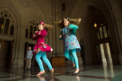 Photo: Two young girls dance in the National Cathedral, Washington, District of Columbia.