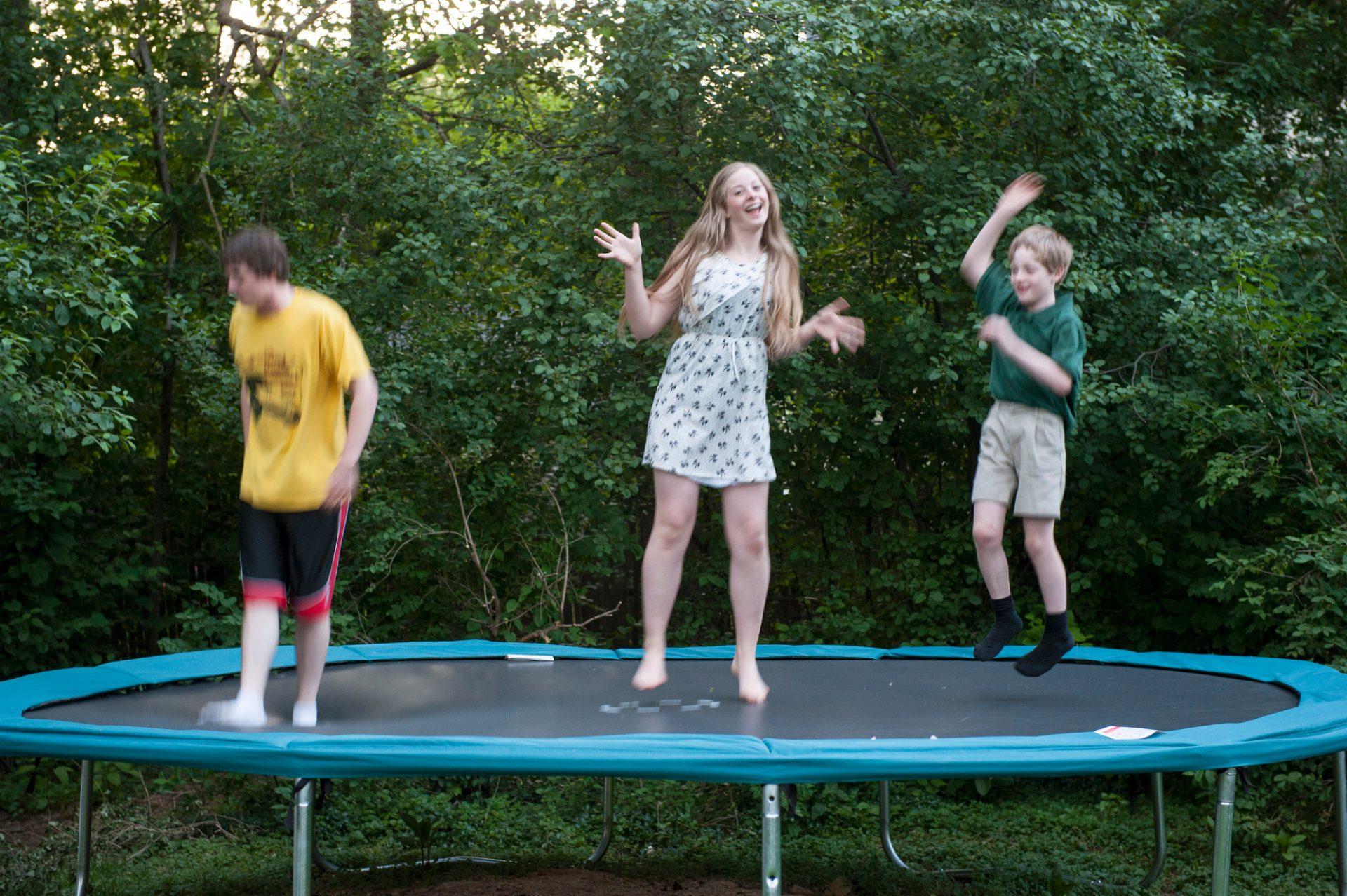 Photo: Three siblings jump on a trampoline in Lincoln, Nebraska.