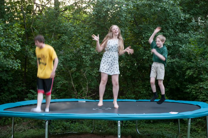 Photo: Three siblings jump on a trampoline in Lincoln, Nebraska.