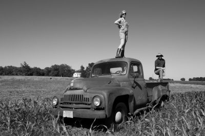Photo: Two teenagers stand on top of an old International Harvester truck on a farm in Bennet, Nebraska.