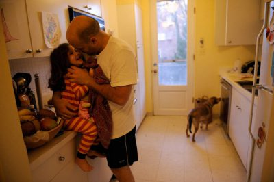 Photo: A father and his daughter in the kitchen of their home.