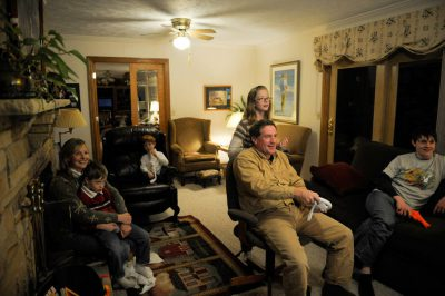 Photo: A family plays a video game using motion-sensing controls.