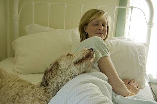 Photo: A woman naps with the family dog in Lincoln, Nebraska.