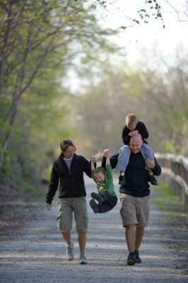 Photo: A family walking along the Steamboat Trace trail between Nebraska City and Peru, Nebraska.