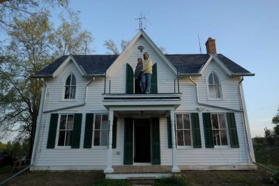 Photo: A mother and daughter stand a top their old farmhouse in Dunbar, Nebraska.
