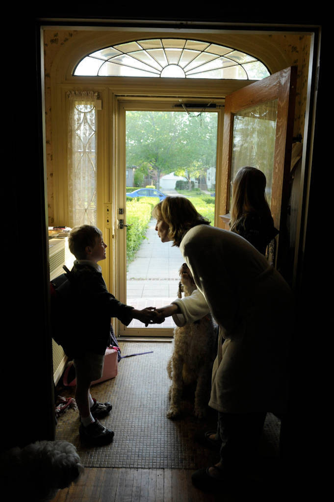 Photo: A mother tells her children good-bye at their house as they leave for school in the morning in Lincoln, Nebraska.