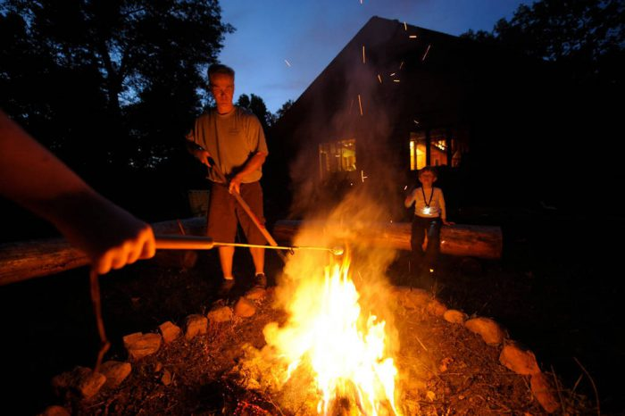 Photo: A family roasting marshmallows while on vacation at their home near Crosslake, Minnesota.