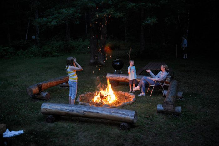 Photo: A family roasts marshmallows over a campfire while on vacation near Crosslake, Minnesota.