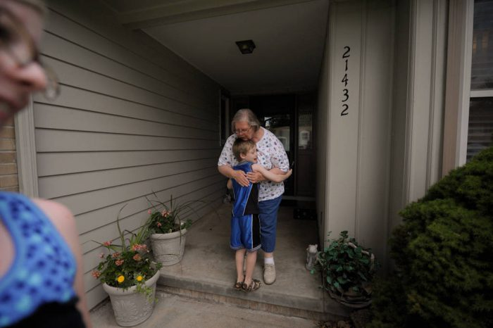 Photo: A boy (age 6) hugs his grandmother Sharon Sartore outside a home in eastern Nebraska.
