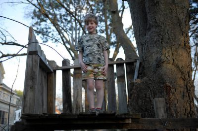 Photo: A young boy stand proudly in his treehouse at his home in Lincoln, Nebraska.