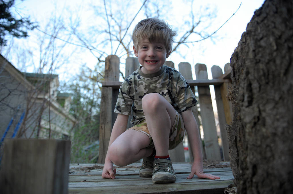 Photo: A young boy kneels proudly in his treehouse at his home in Lincoln, Nebraska.
