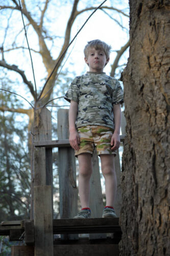 Photo: A young boy stands proudly in his treehouse at his home in Lincoln, Nebraska.