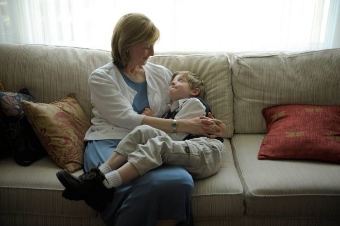 Photo: A mother comforts her young son on their couch at their home in Lincoln, Nebraska.
