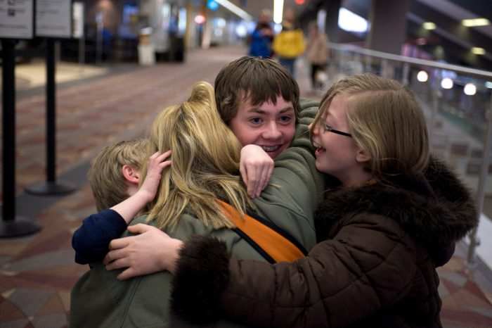 Photo: A woman is greeted by her children in the airport after a month-long trip to Antarctica