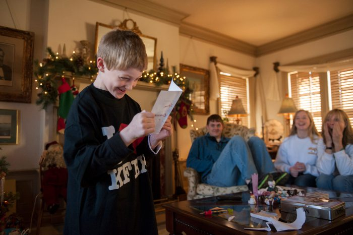 Photo: A young boy receives a birthday present in Lincoln, Nebraska.