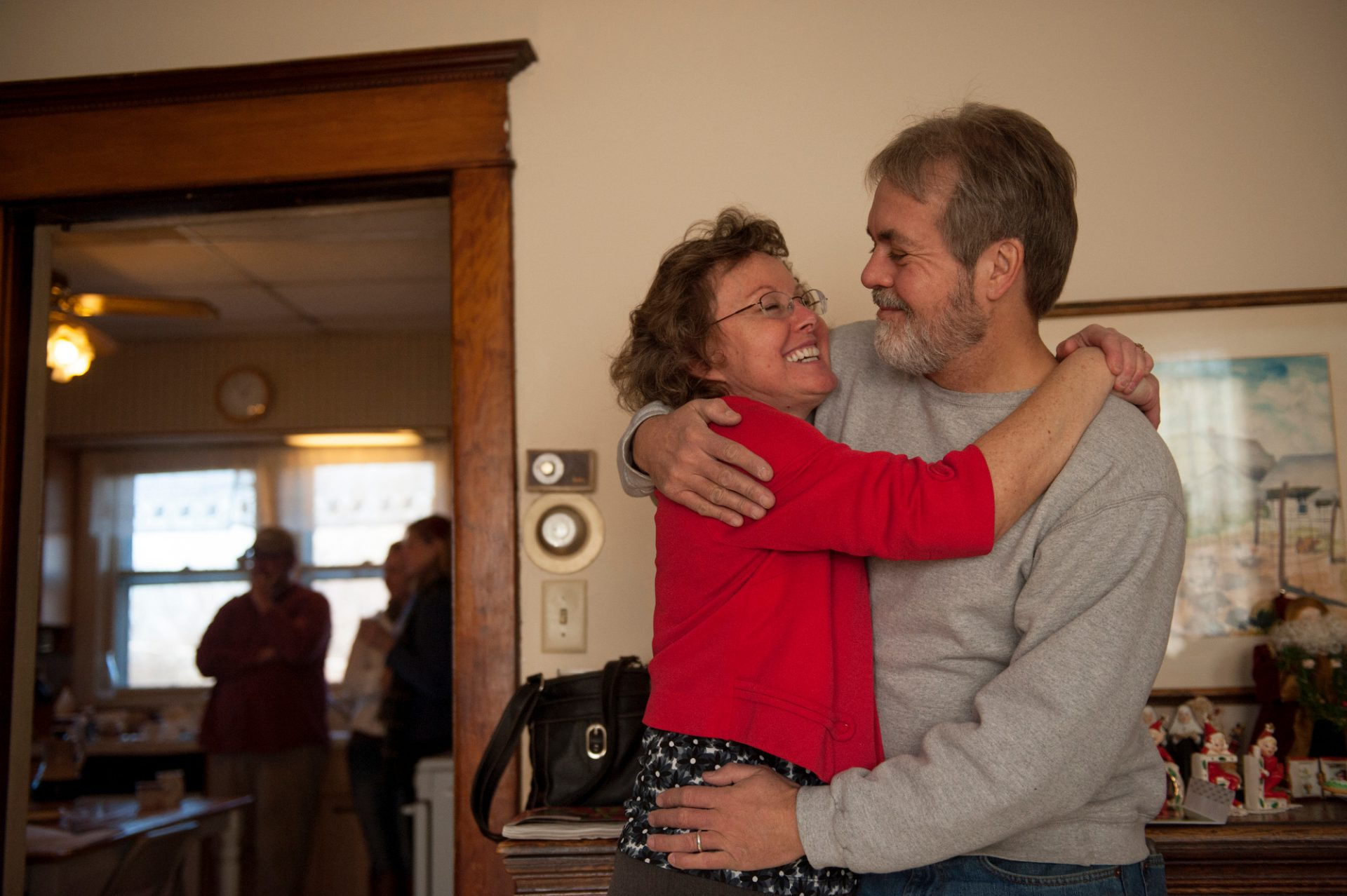 Photo: A husband and wife embrace in Lincoln, Nebraska.