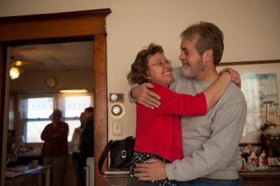 Photo: A husband and wife embrace in Lincoln, Nebraska.