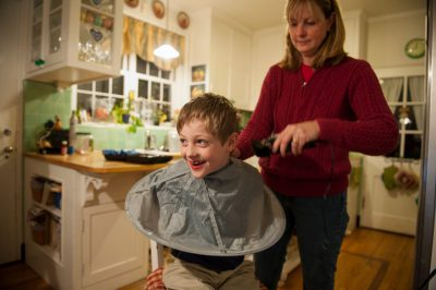 Photo: A young boy has his hair cut in Lincoln, Nebraska.