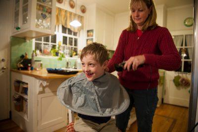 Photo: A young boy has his hair cut in Lincoln, Nebraska.