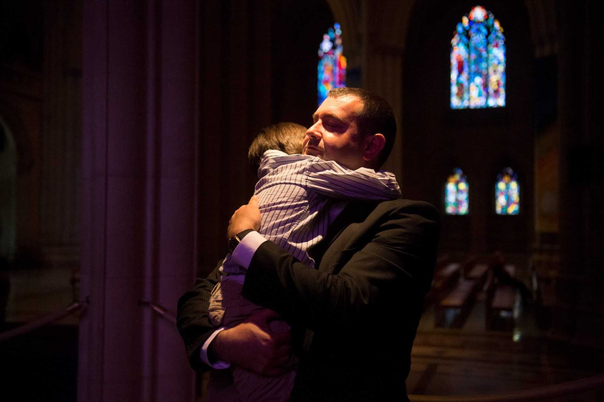 Photo: A father holds his son at the National Cathedral, District of Columbia.