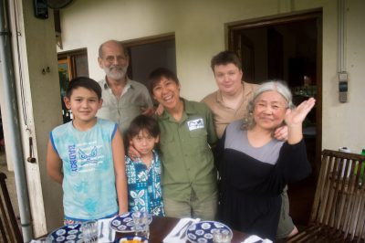 Photo: A family poses for a photo just before a meal in Vietnam.