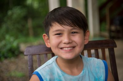 Photo: An elementary age boy smiles for a photo.