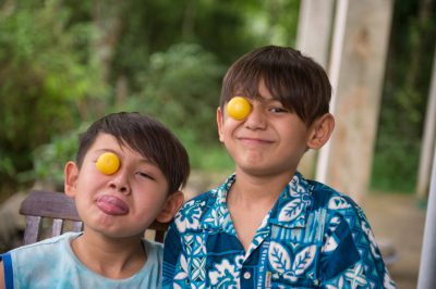 Photo: Two elementary age boys make funny faces.