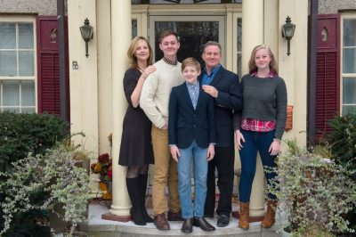 Photo: A family gathers for a portrait at their home.