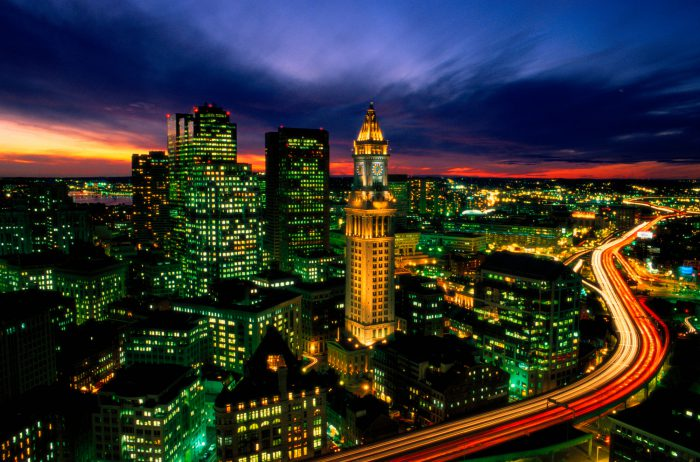 Photo: An aerial of Boston, Massachusetts at night with time exposure car lights, the Custom House tower is seen.