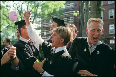 Photo: A group of Harvard graduates celebrate on campus in Boston, Massachusetts.
