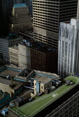 Photo: A person running on a roof top track at the Boston Racquet Club.
