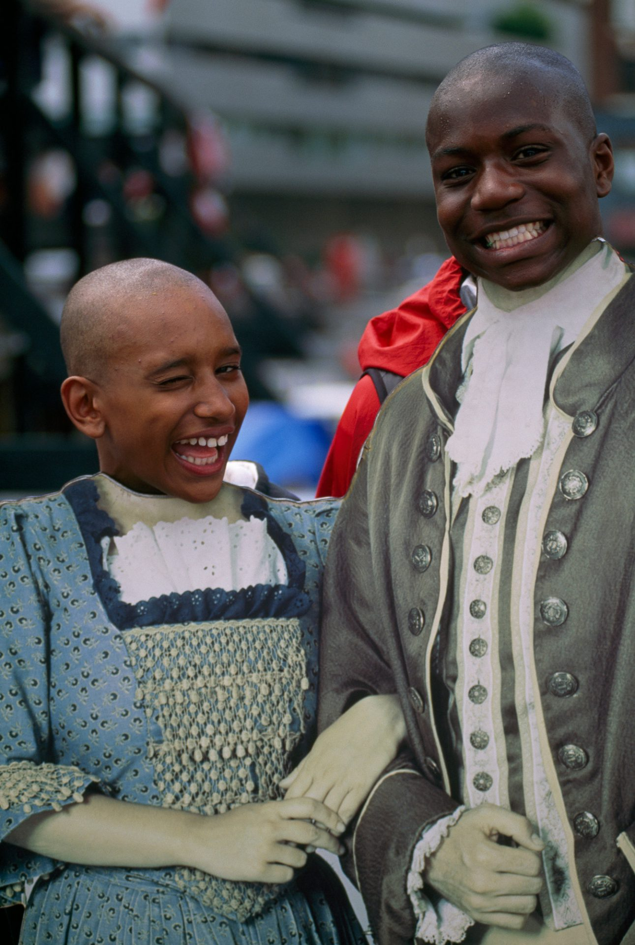 Photo: Two young boys pose behind colonial cutouts at the Boston Tea Party ship in Boston harbor, Massachusetts.