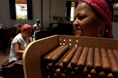 Photo: Women hand-roll cigars at a factory in Salvador, Brazil.