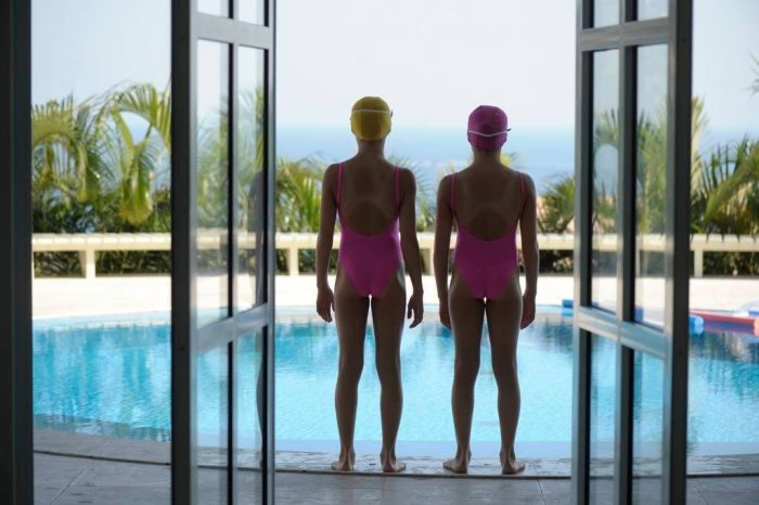 Photo: Two girls stand by a swimming pool in the Joa neighborhood in Rio de Janeiro, Brazil.