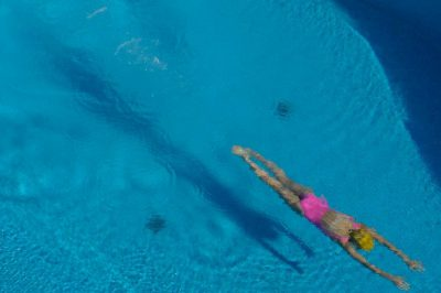 Photo: A girl swims in the pool of a house in the Joa neighborhood of Rio de Janeiro, Brazil.