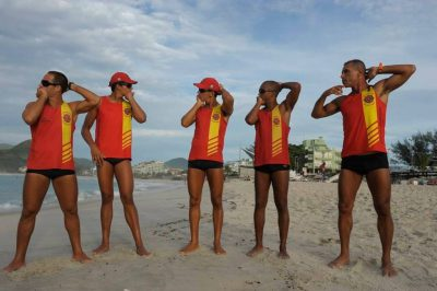 Photo: Lifeguards stretch on the beach in Rio de Janeiro, Brazil.