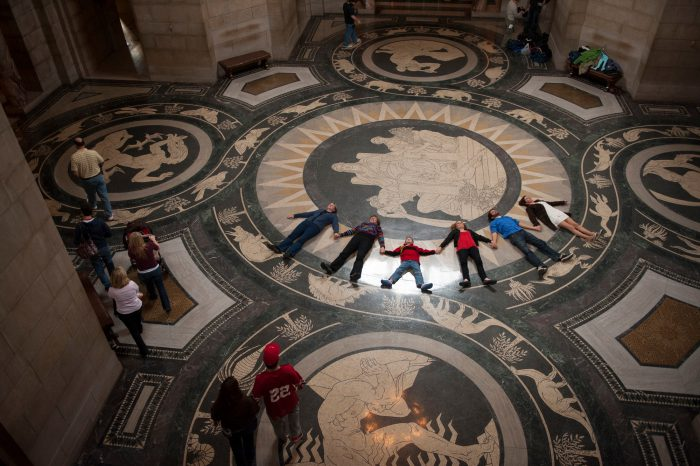 Photo: A tour group observes the rotunda ceiling of the Nebraska State Capitol Building.