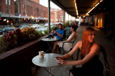 Photo: A woman waits for her date at a coffee shop in Lincoln's Haymarket area.