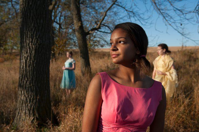 Photo: Three teenage girls model dresses on the edge of a Nebraska prairie.