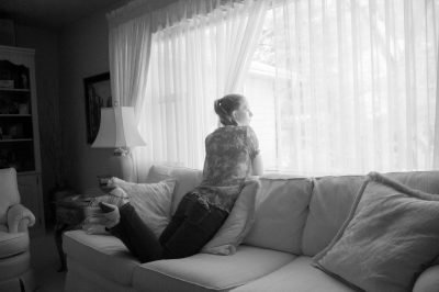 Photo: A teenage girl looks out the window in Elkhorn, Nebraska.