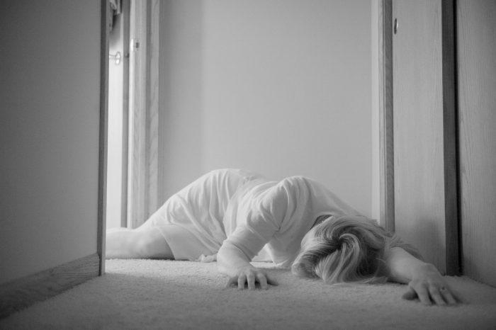Photo: An unconscious woman lays on the floor in Elkhorn, Nebraska.