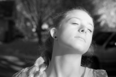 Photo: A teenage girl basks in the eerie afternoon light in Elkhorn, Nebraska.