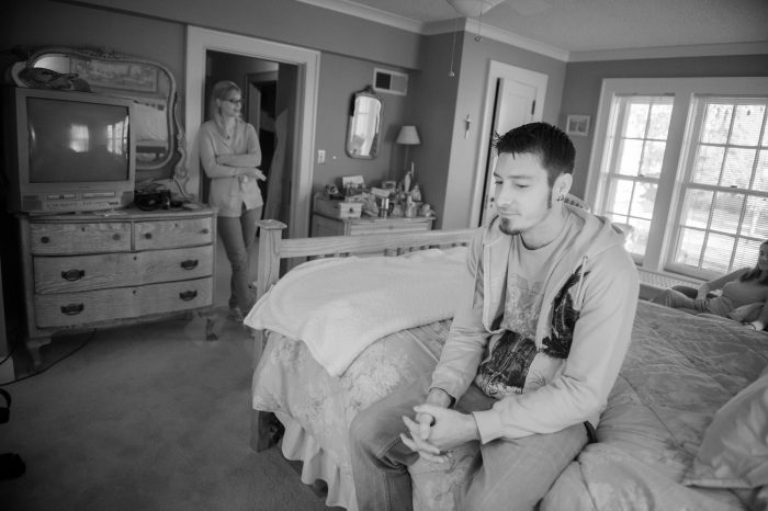 Photo: Three young adults in a bedroom in Lincoln, Nebraska.