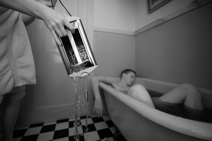 Photo: A woman appears to have electrocuted a man in a bathtub with a toaster in Lincoln, Nebraska.