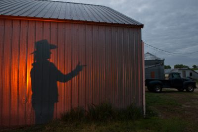 Photo: The silhouette of a woman wearing a cowboy hat and pointing her finger like a gun.