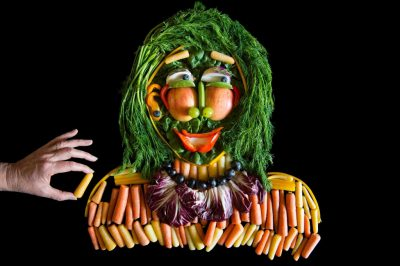 Photo: A still life of a person made with fruits and vegetables.