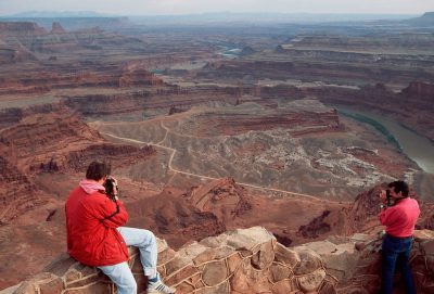 Photo: Tourists photographing the Colorado River as it winds through Deadhorse Point State Park in Utah.