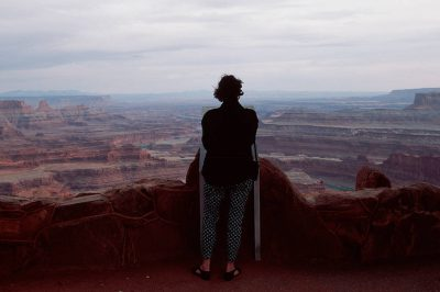Photo: A tourist looks out over the Colorado River as it winds through Deadhorse Point State Park in Utah.