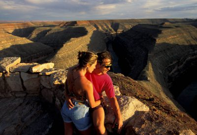 Photo: A couple looks out over the canyons at Deadhorse Point State Park in Utah.