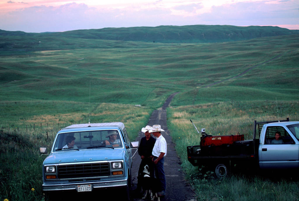 Photo: Ranchers stop to talk on a country road in Nebraska's Sandhills.